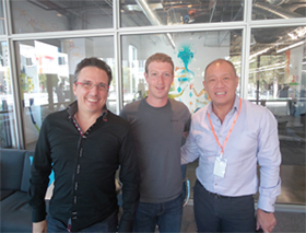 Facebook's Mark Zuckerberg with Globe execs