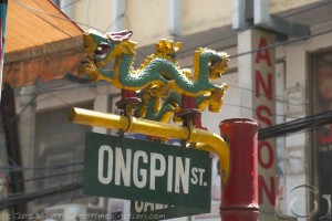 A streetsign at Ongpin street decorated with an ornate Chinese dragon