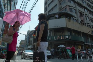 Two Chinese Ladies Chatting At A Street Corner